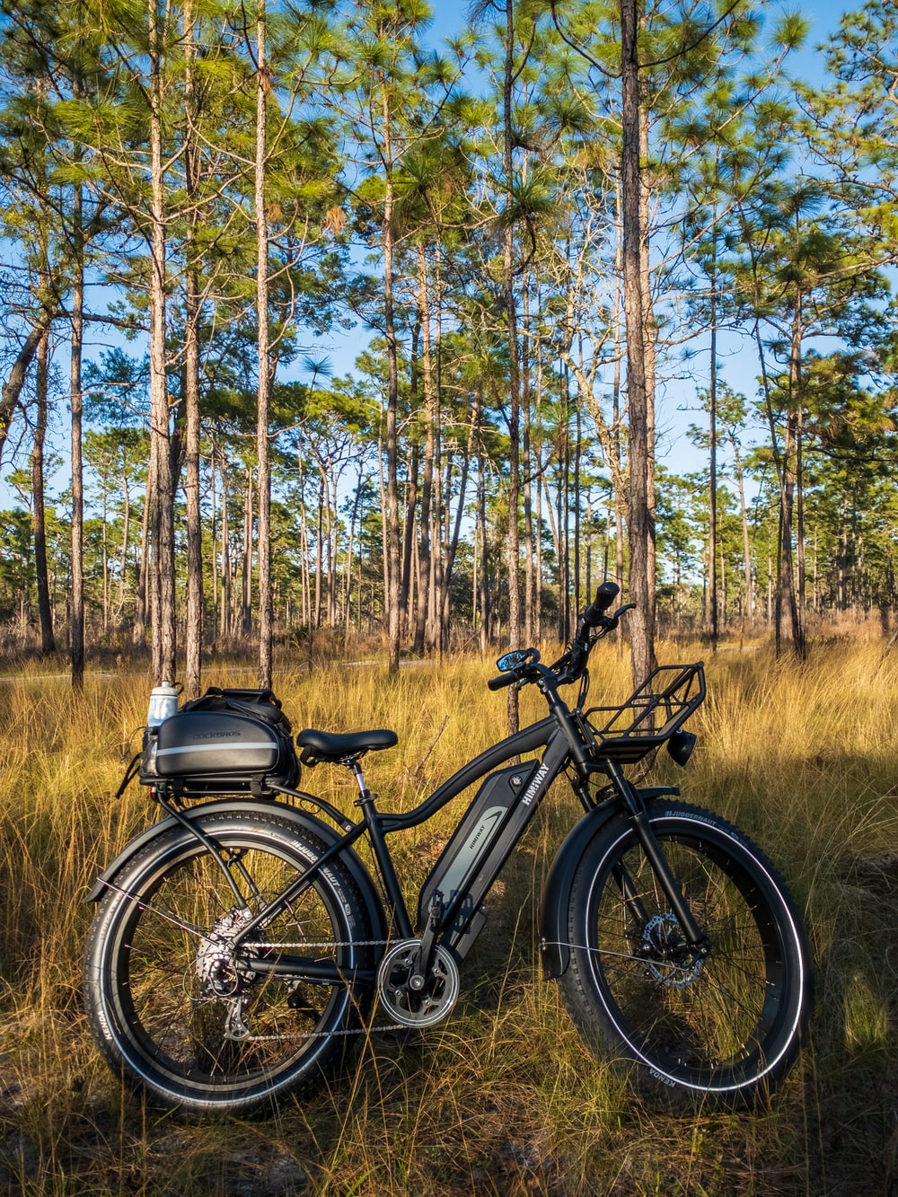 black and gray mountain bike on brown grass field during daytime