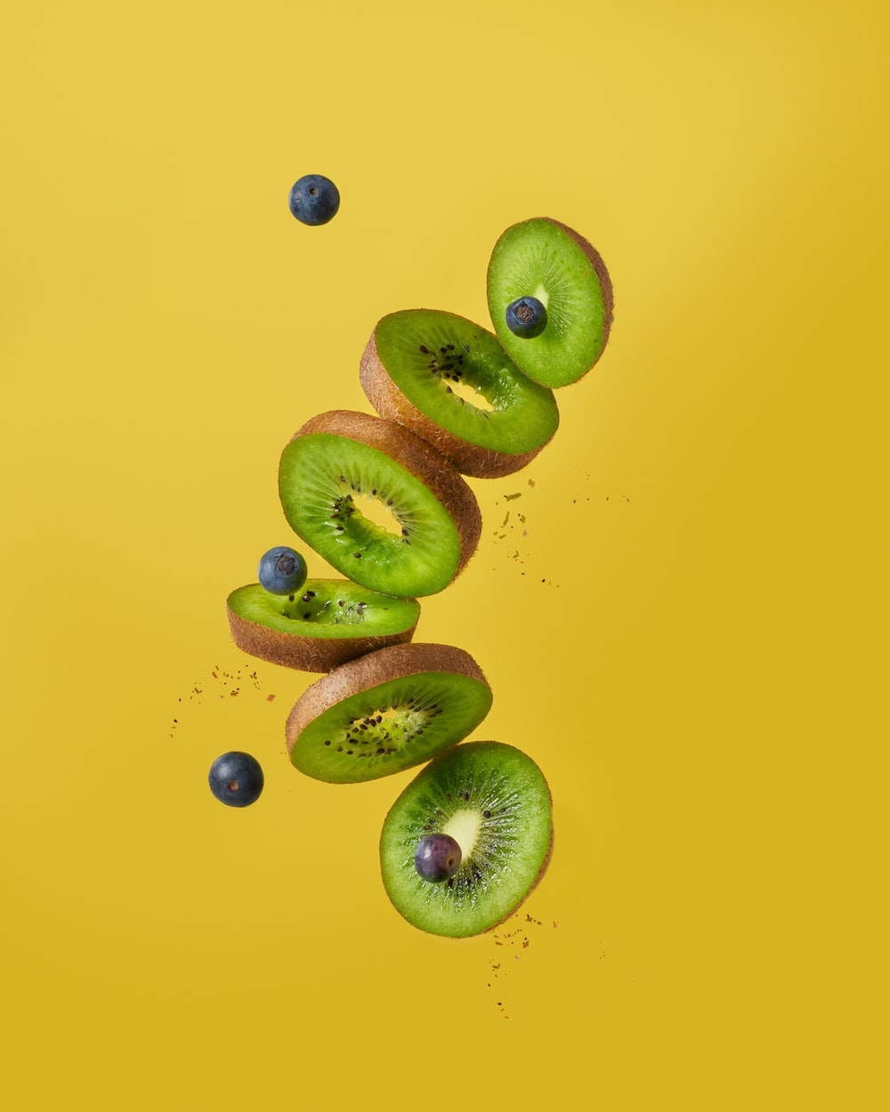 green and brown fruits on blue surface