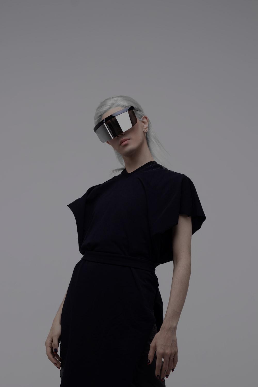woman in black dress wearing white headphones