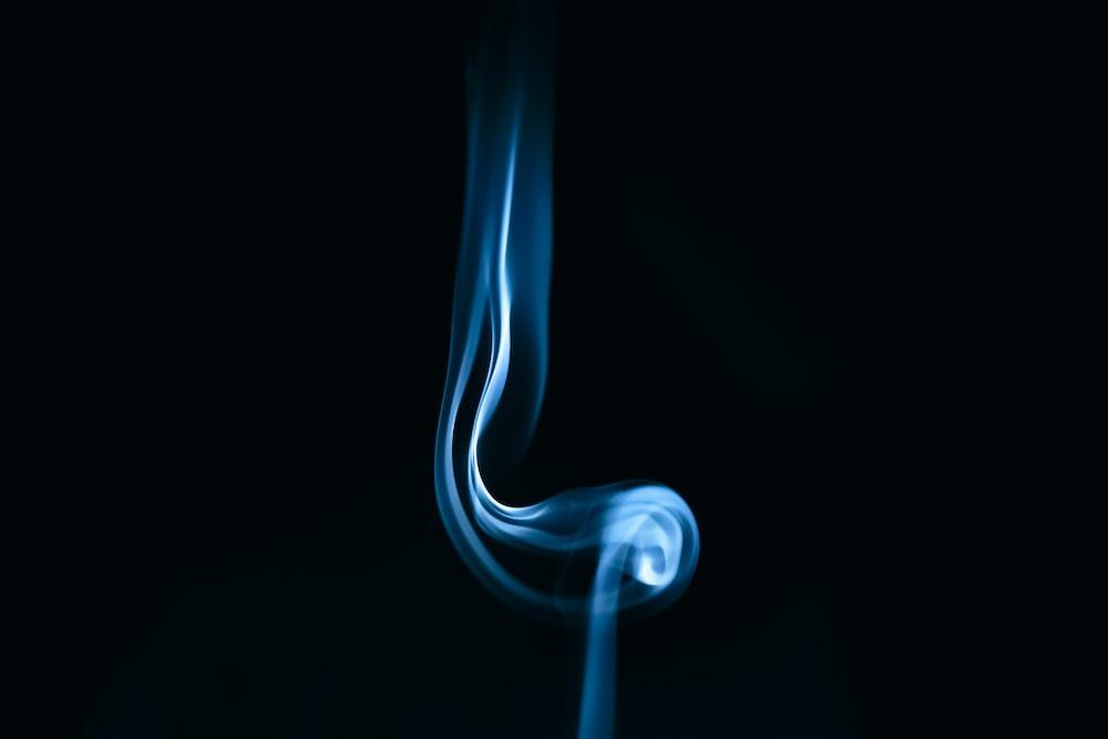 white smoke in black background
