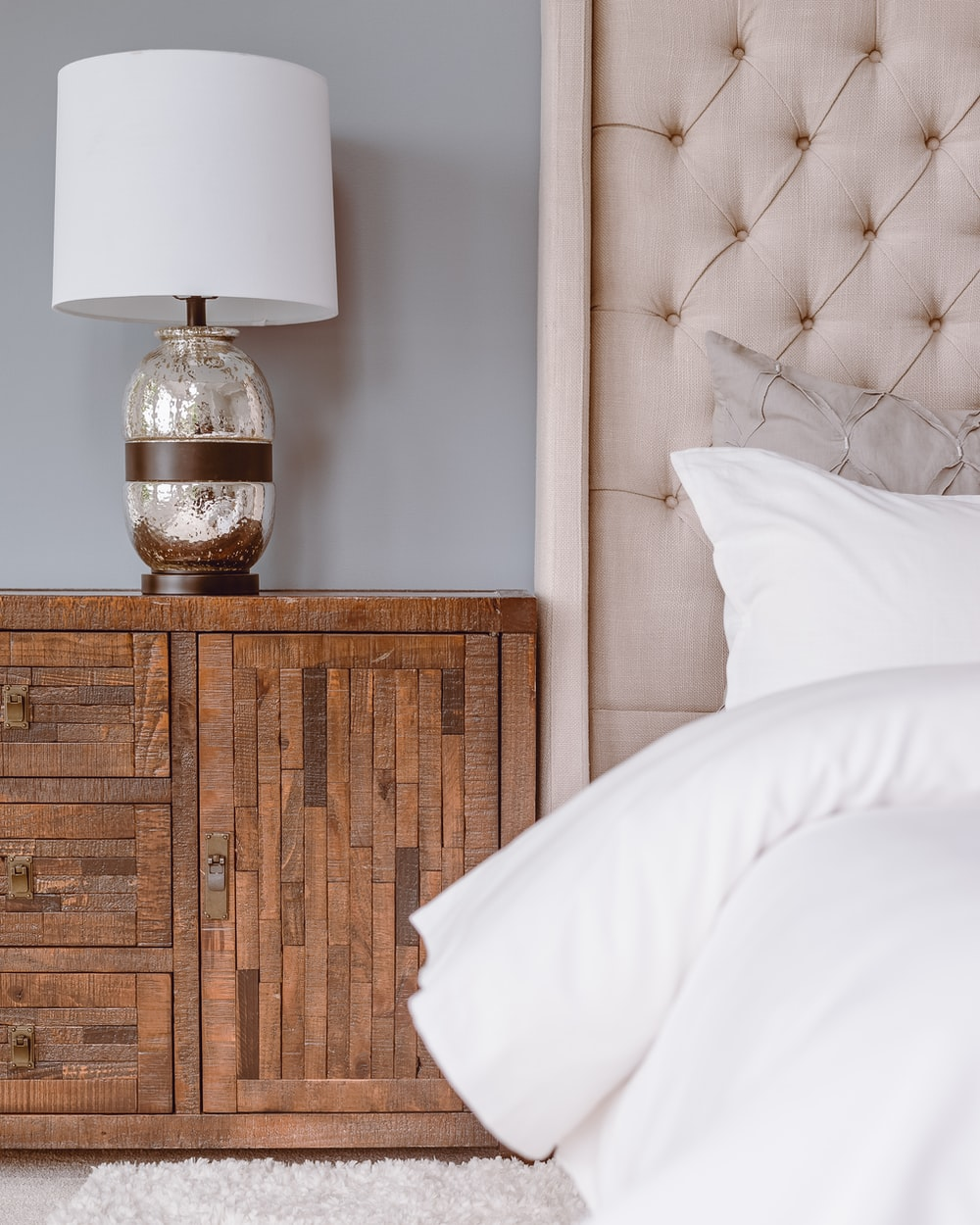 white table lamp on brown wooden drawer