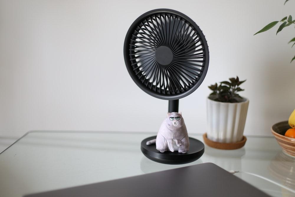 white and black desk fan