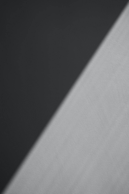 white textile in dark room