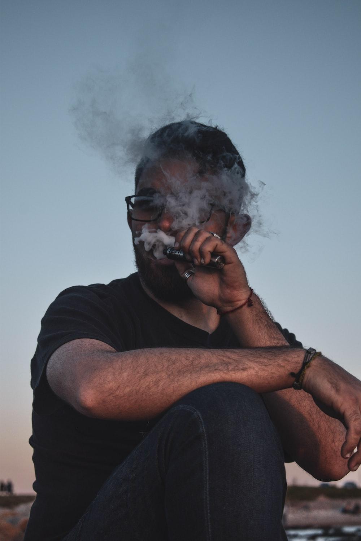 man in black crew neck t-shirt smoking
