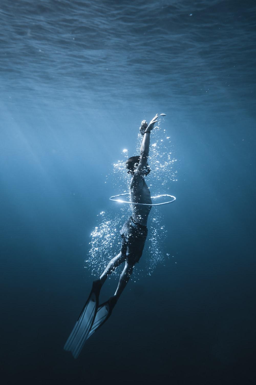 woman in black and white bikini swimming in the sea