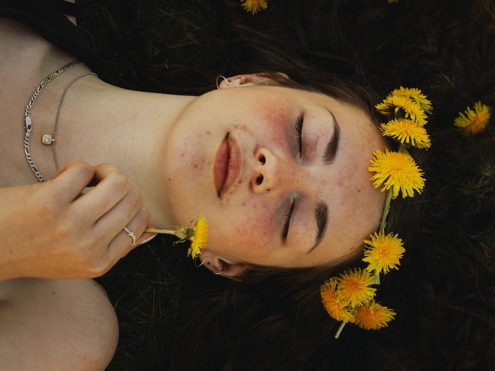 woman lying on yellow flower