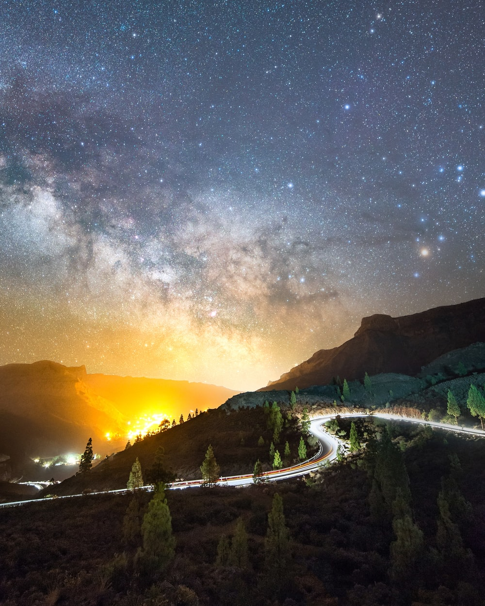 green trees and mountain under starry night