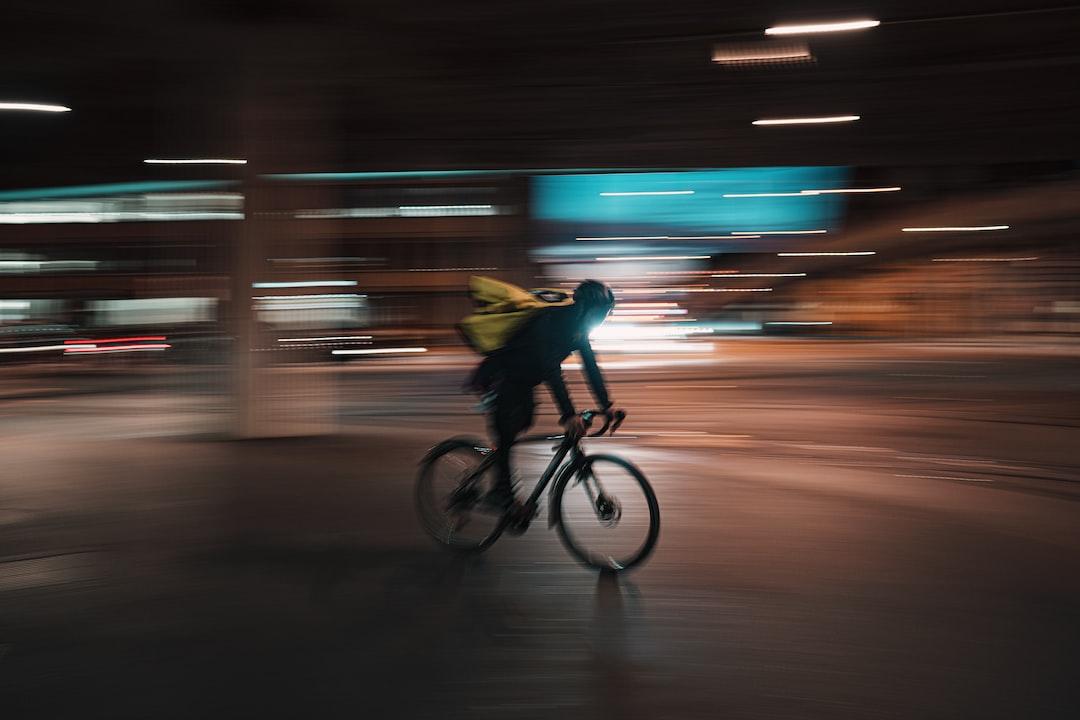 man in yellow shirt riding bicycle