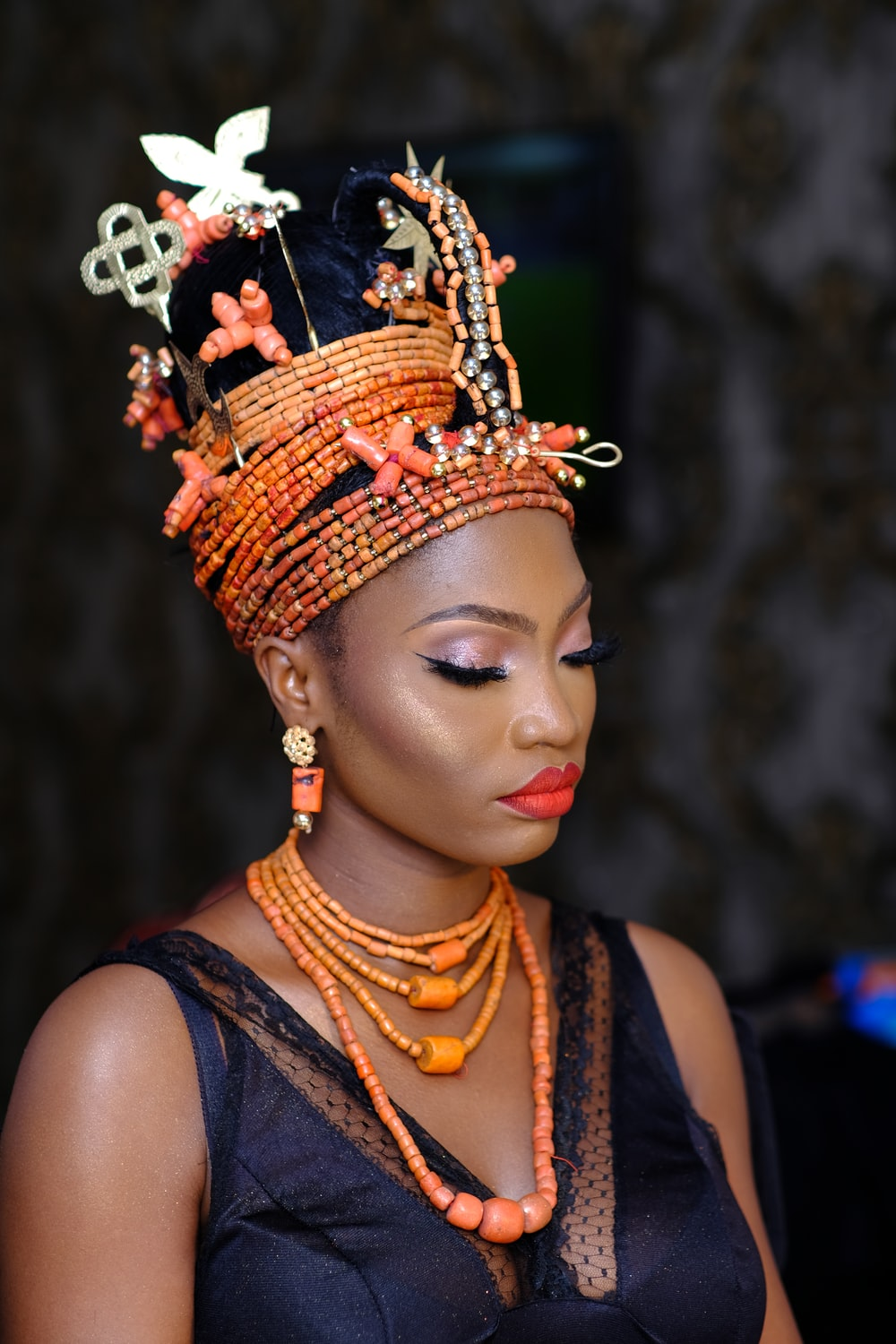 woman in orange and black floral headdress