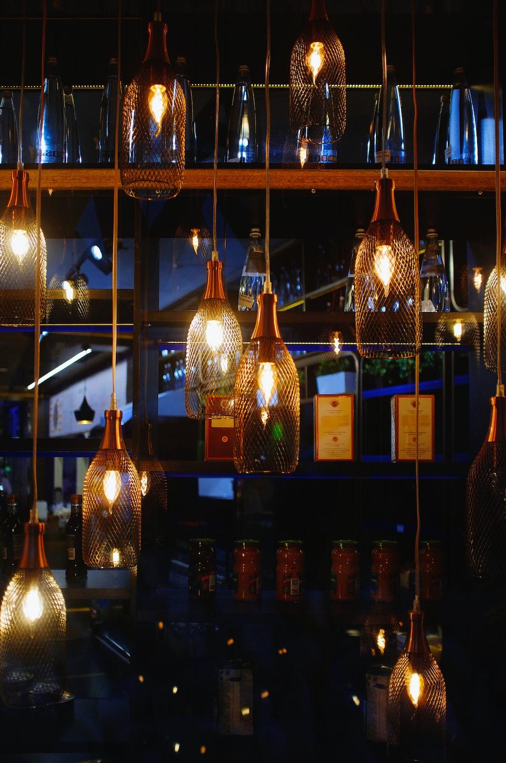 clear glass bottles on brown wooden shelf