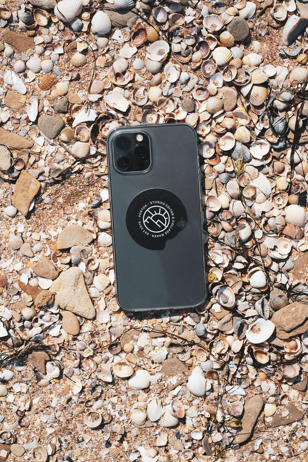 black and white iphone case on brown and gray stones