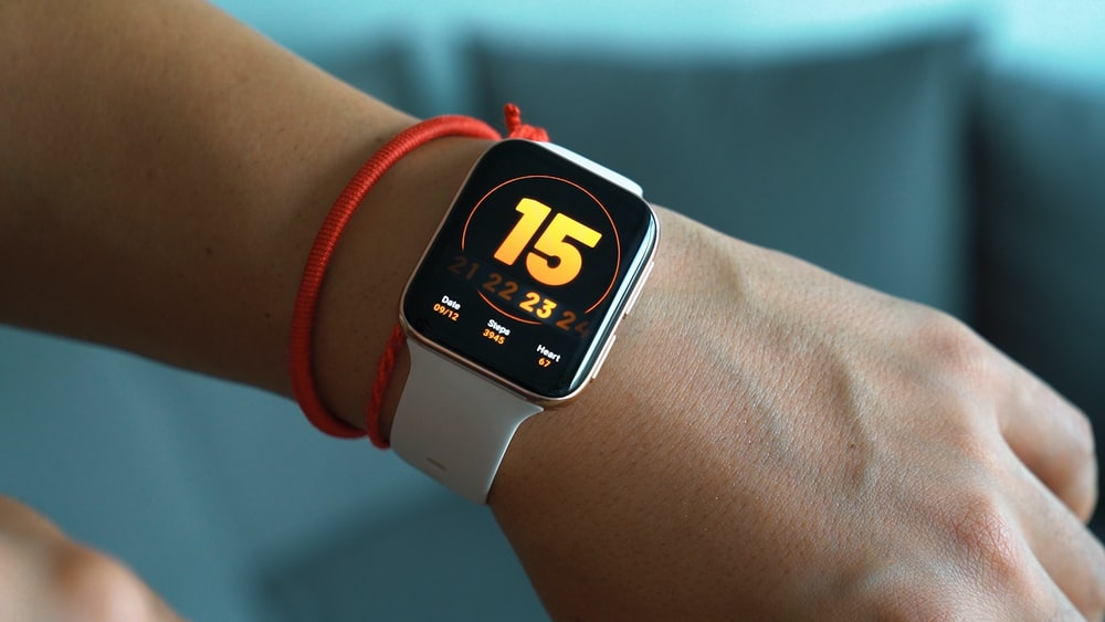 silver aluminum case apple watch with red sport band