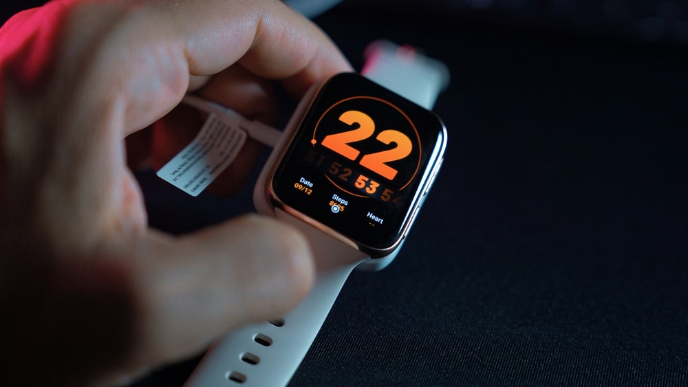 silver aluminum case apple watch with white sport band