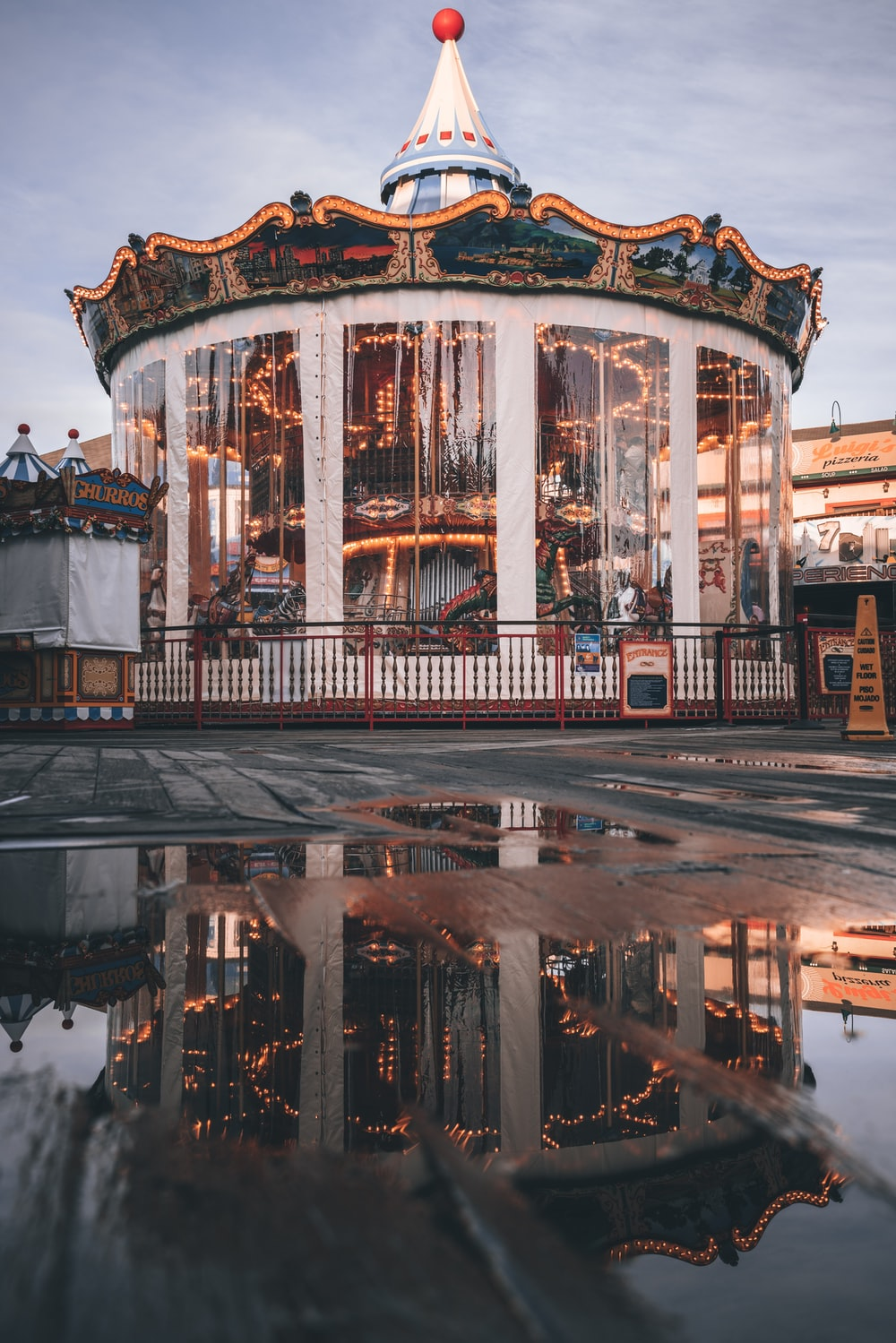 brown and white carousel on a city during night time