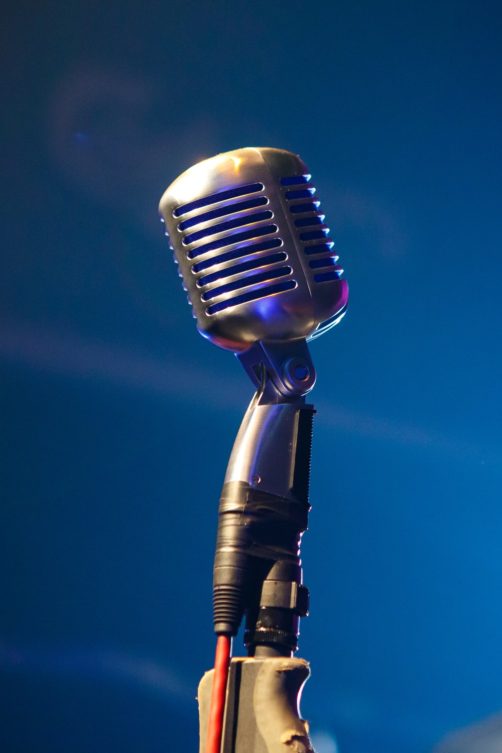 black microphone on blue background