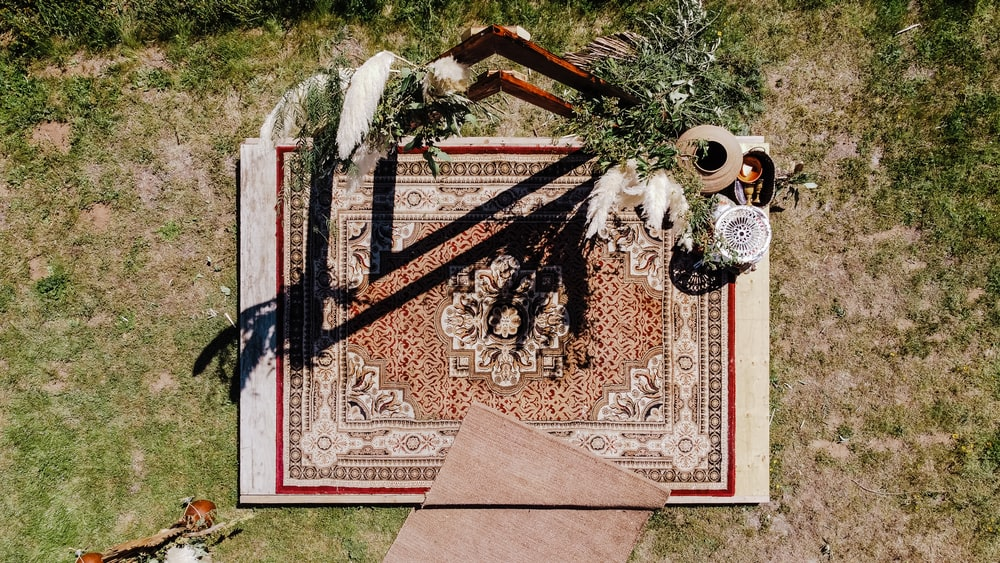 brown and black floral area rug