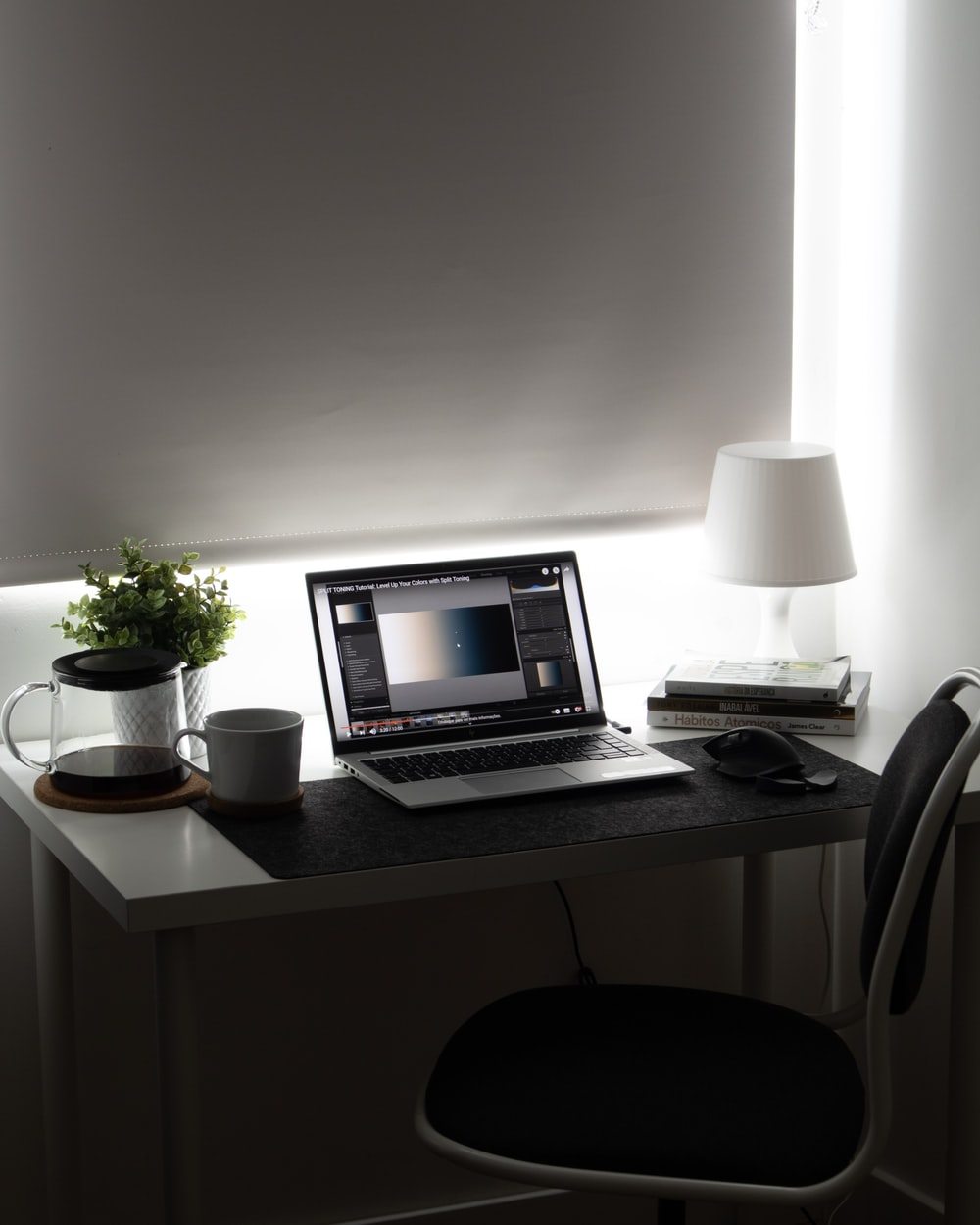 macbook pro on white wooden table