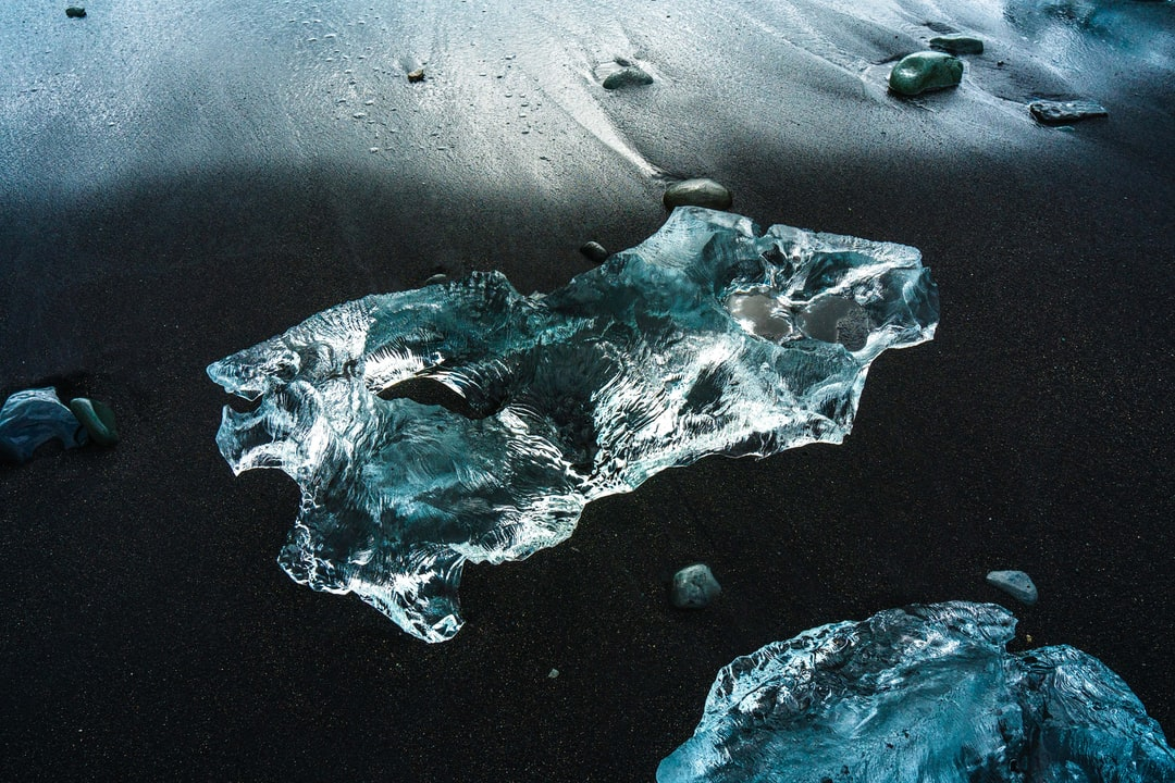 Glacial Ice Washes Ashore On the Black Sand Beach At Diamond Beach, Iceland - unsplash