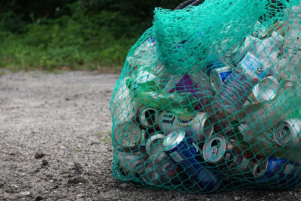 blue plastic bottle in green net