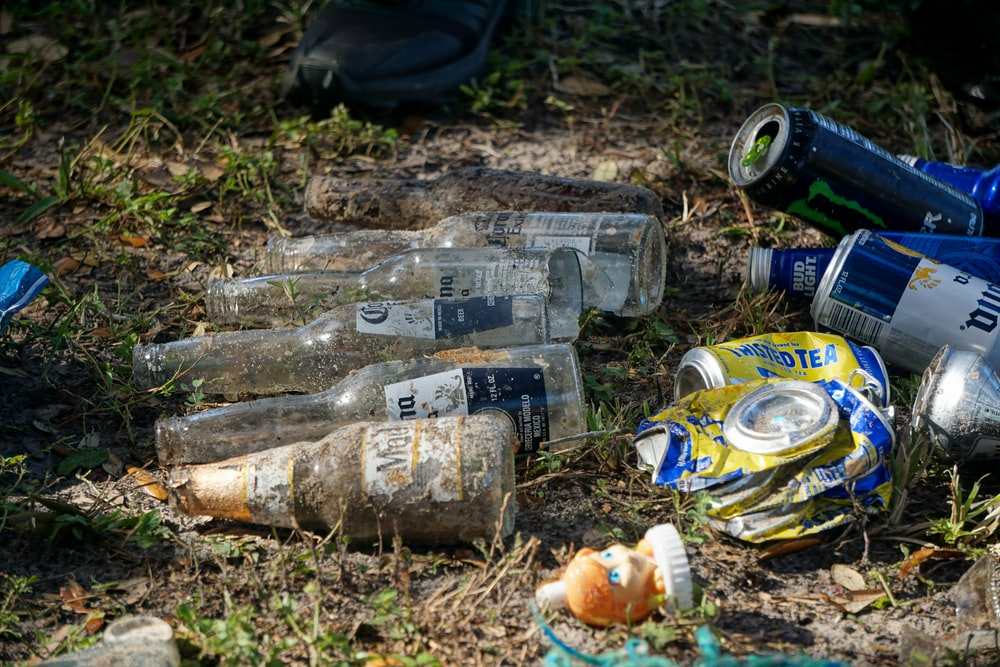 clear glass bottles on ground