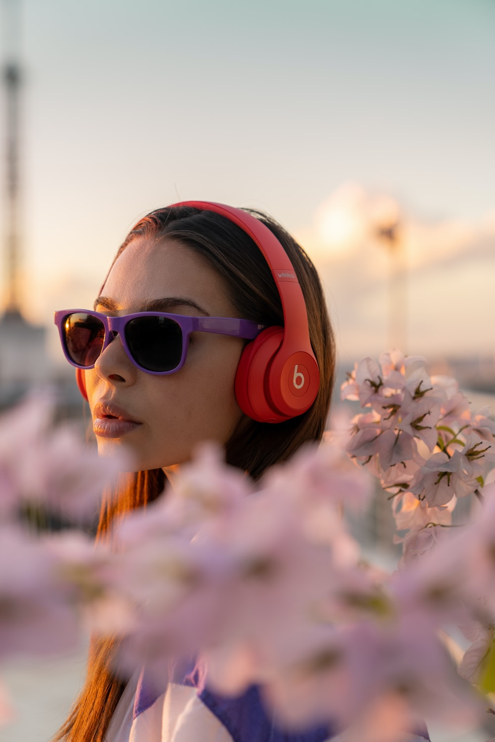 girl in pink sunglasses holding white flowers