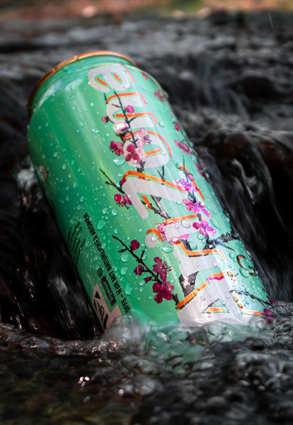 green and red labeled can