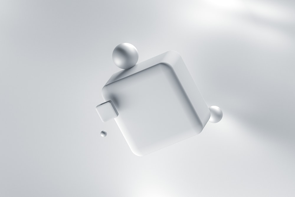 white apple charging adapter on white surface