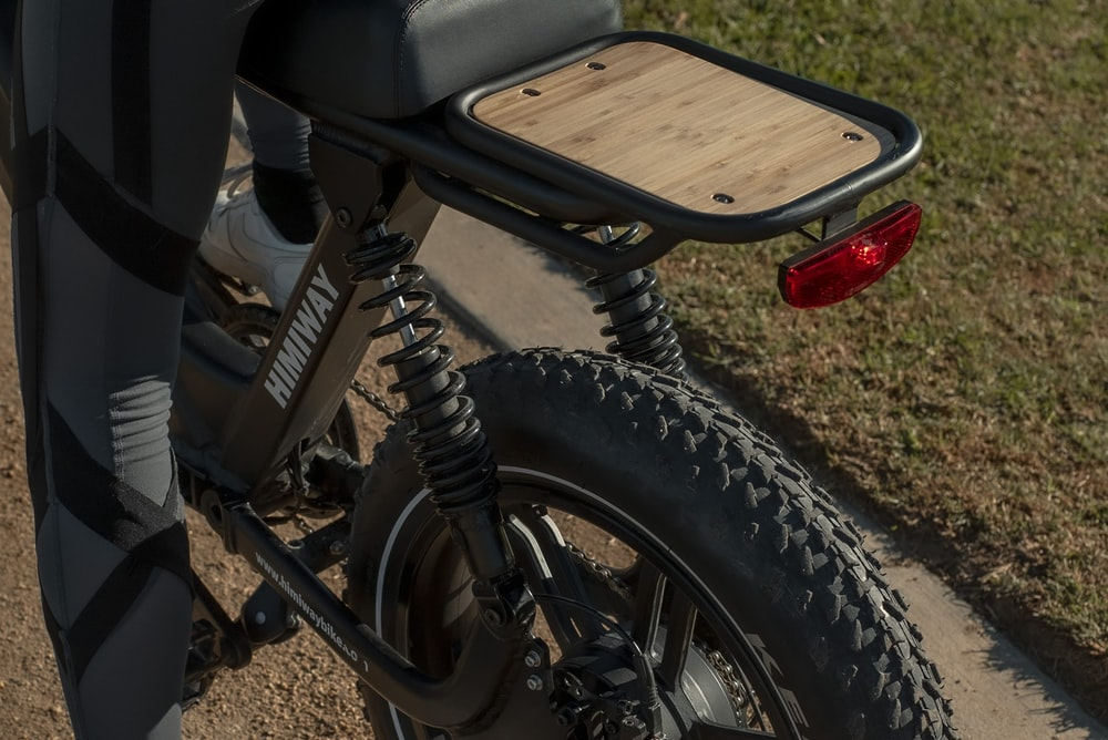 black motorcycle near brown wooden bench