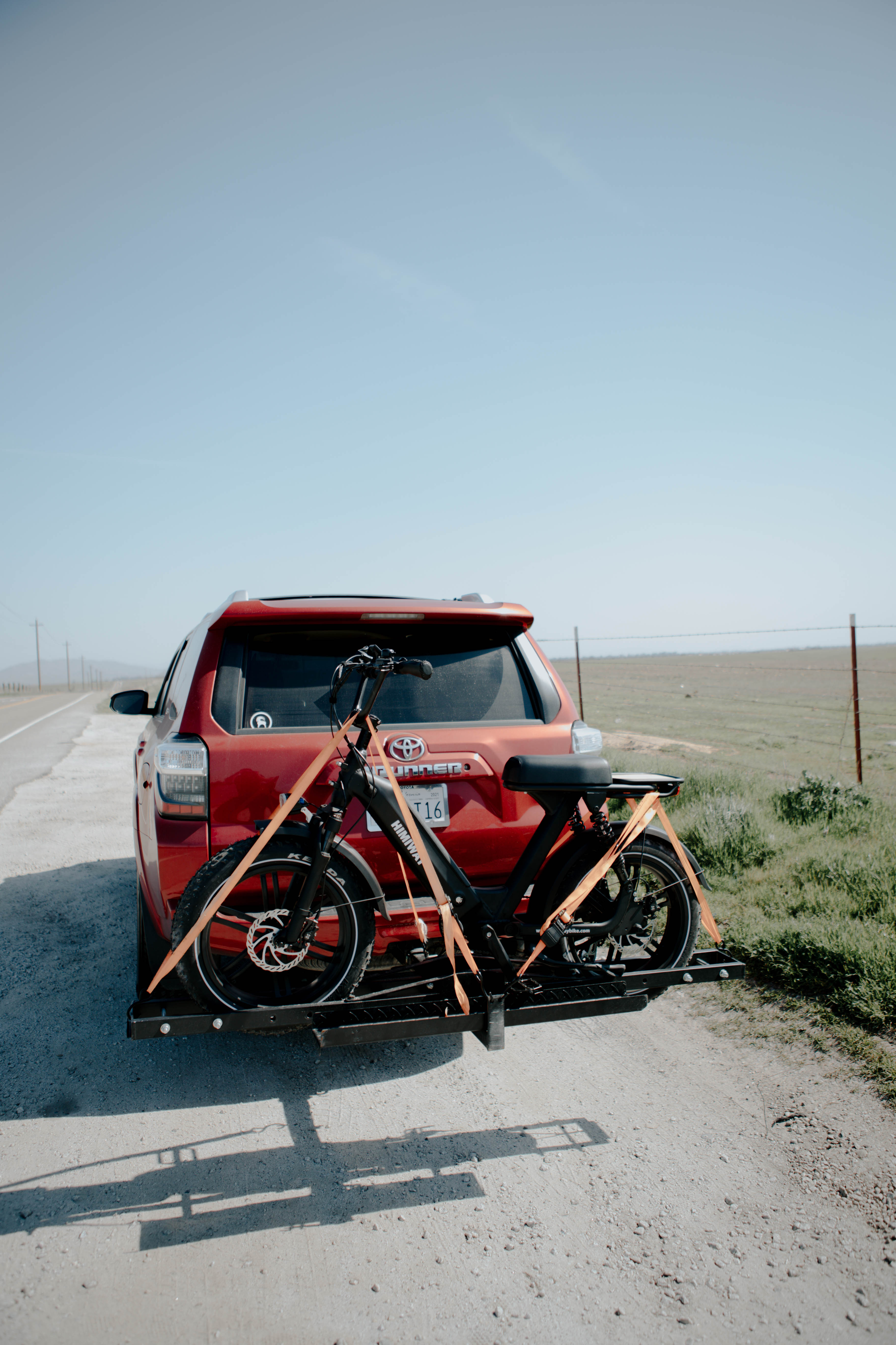 The e-bike can be loaded behind the truck.