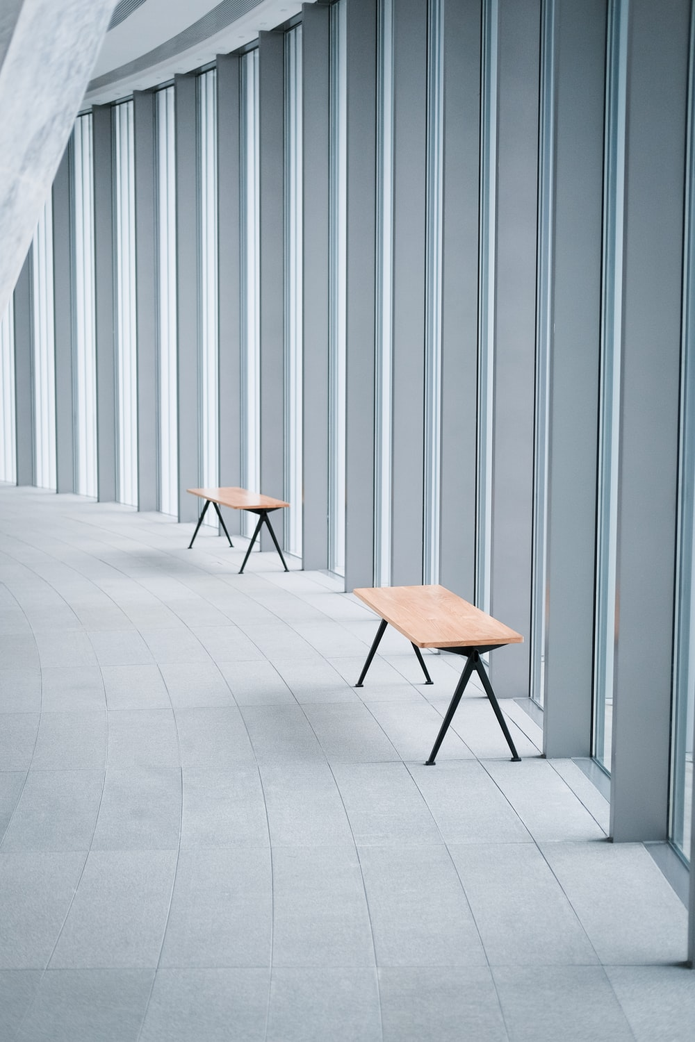 brown wooden chair beside gray wall