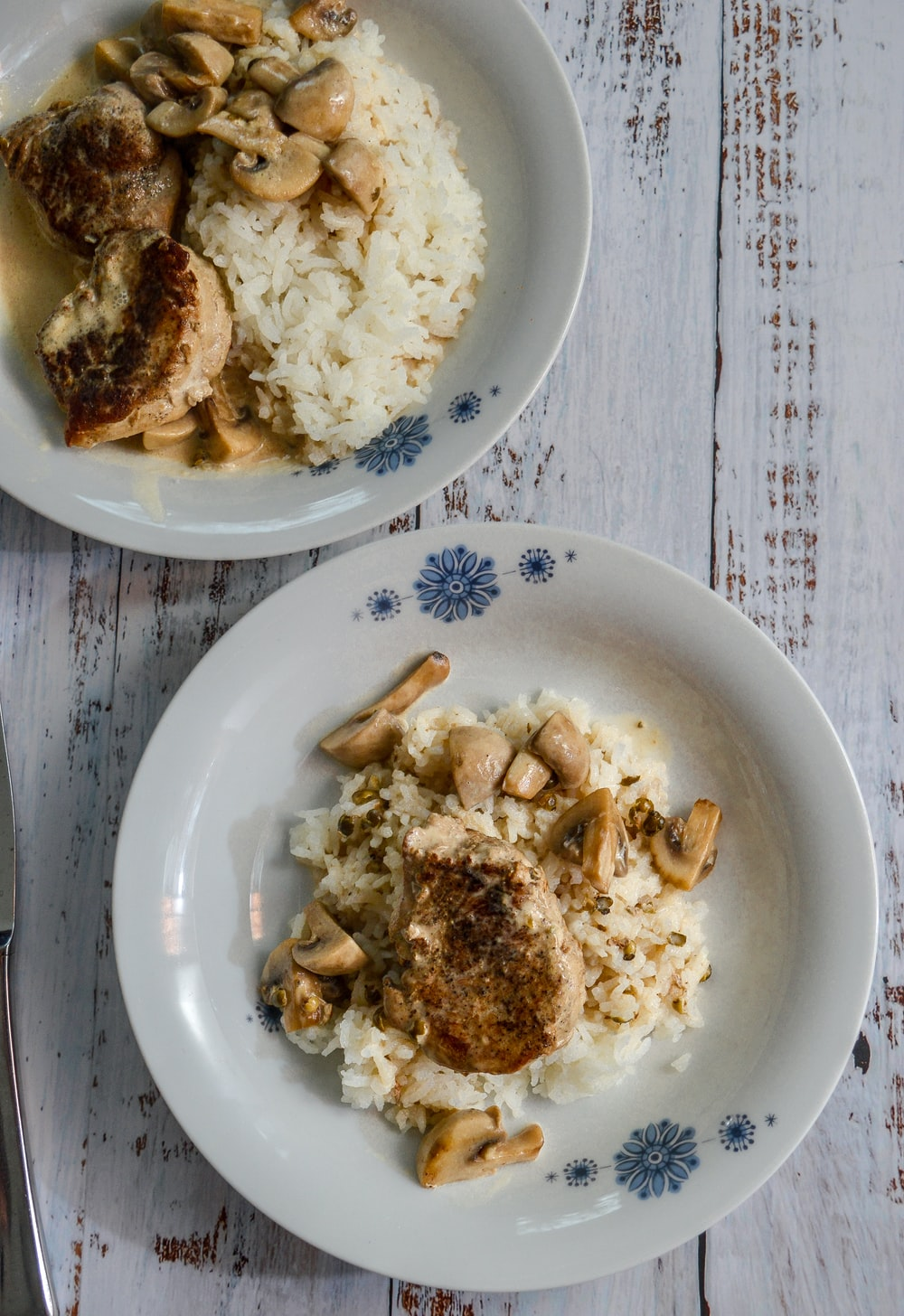 white ceramic plate with rice and fried chicken