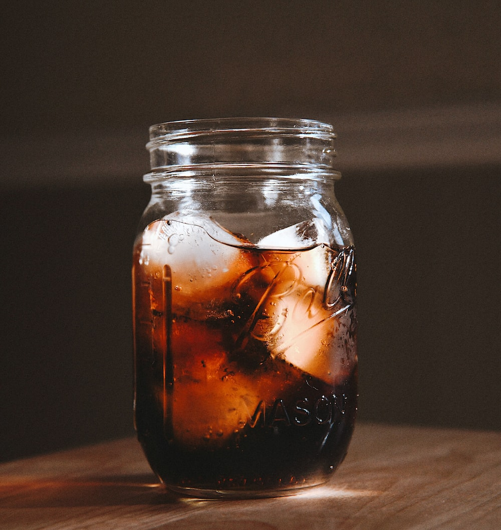clear glass jar with brown liquid inside