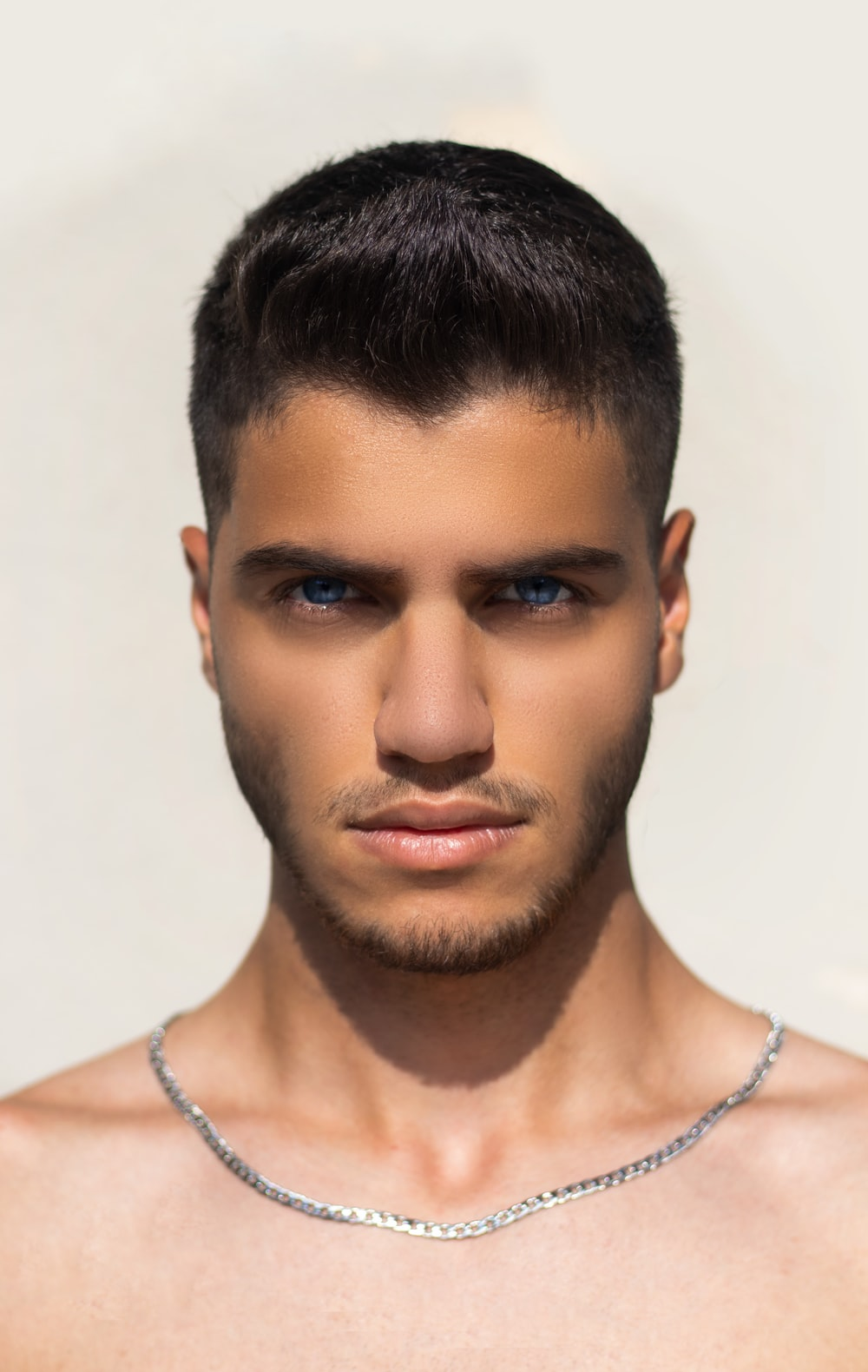 man in silver chain necklace
