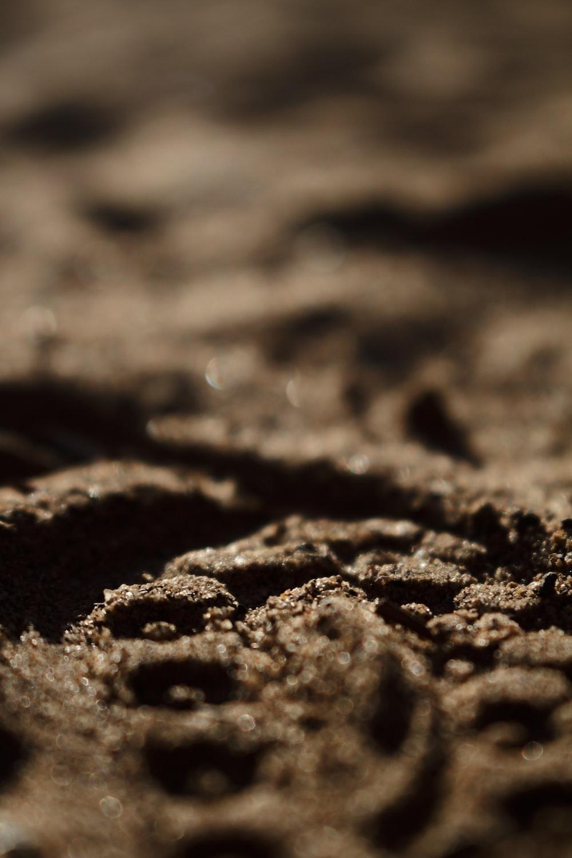 brown and black sand in macro shot