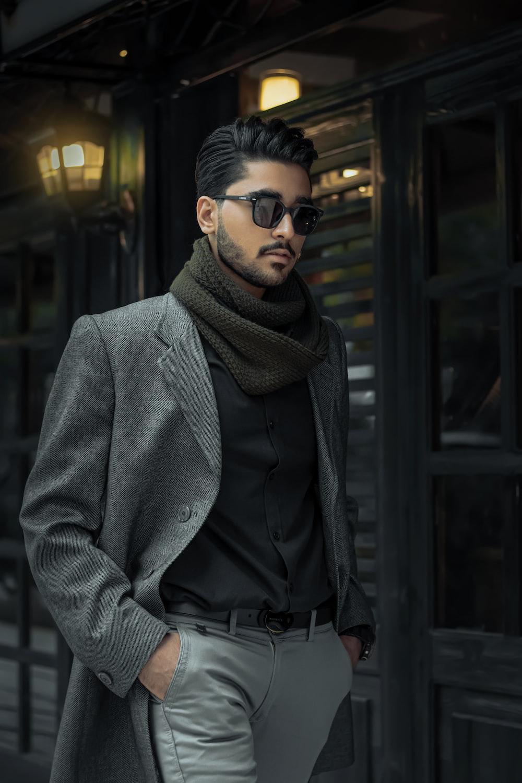 man in gray coat wearing black sunglasses