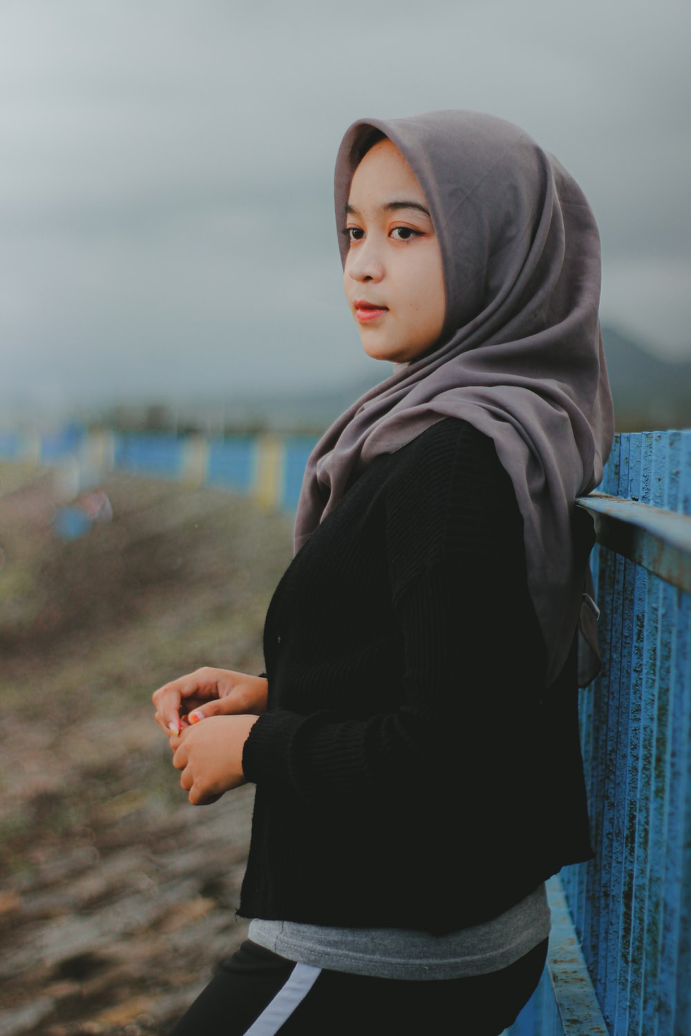 woman in black long sleeve shirt and blue hijab
