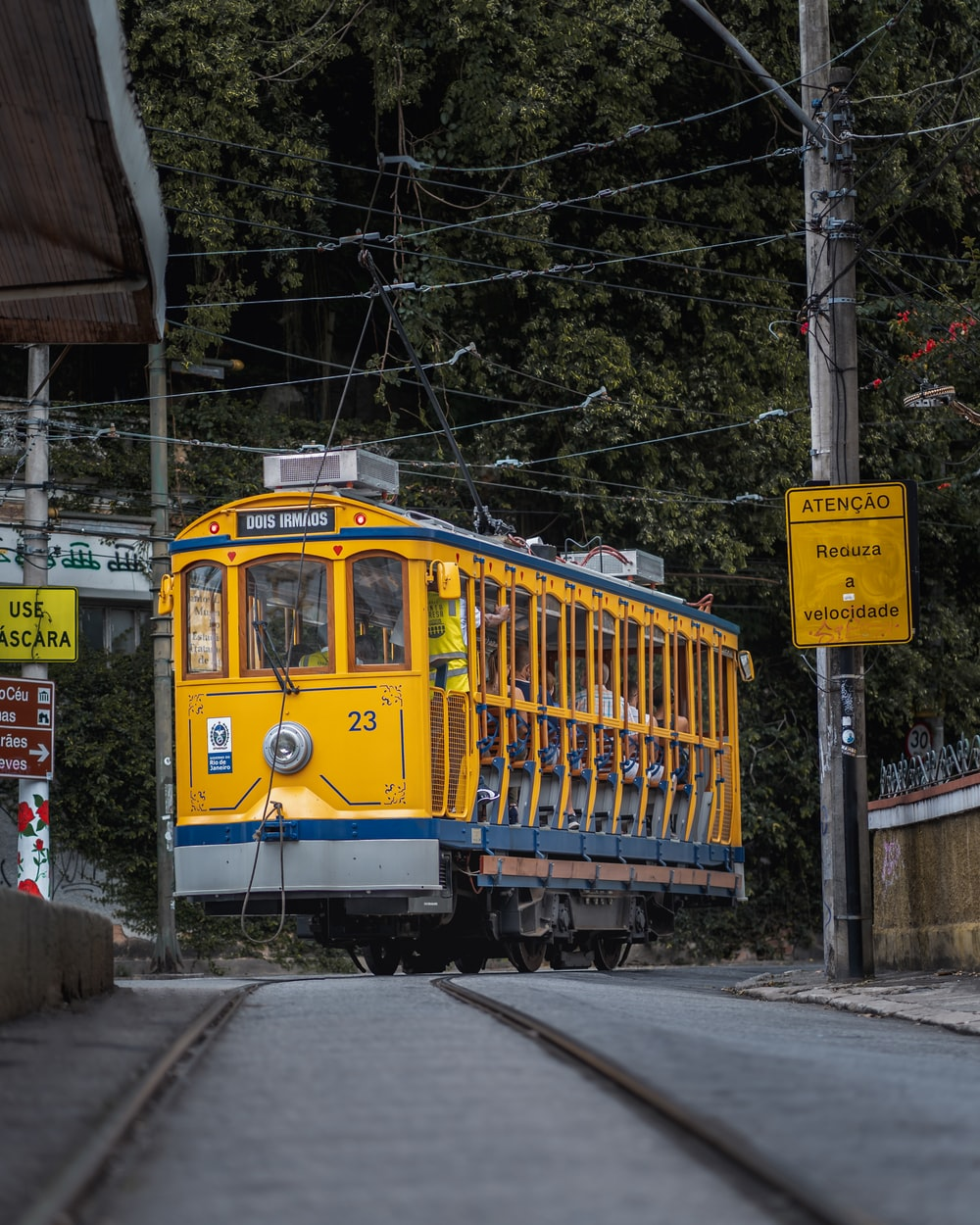 yellow and white tram on the street