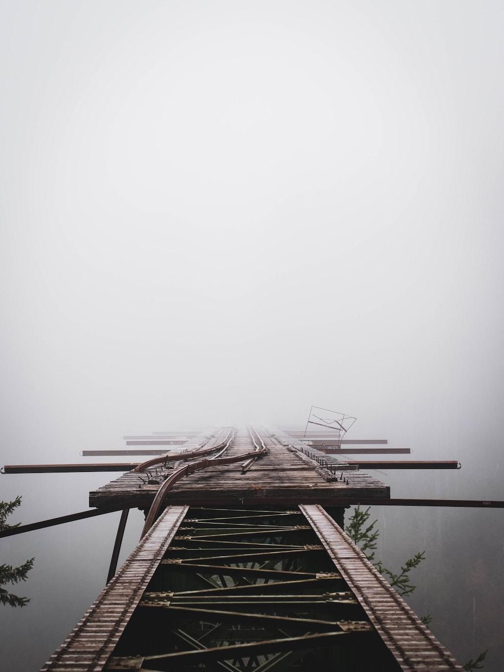 brown wooden ladder on brown wooden ladder