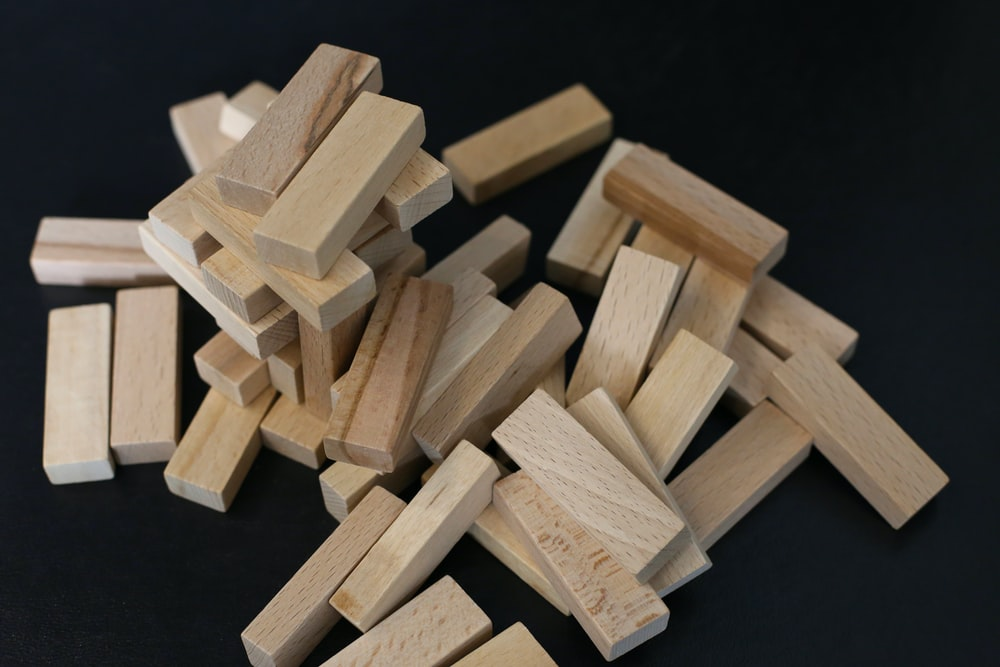 brown wooden blocks on black surface