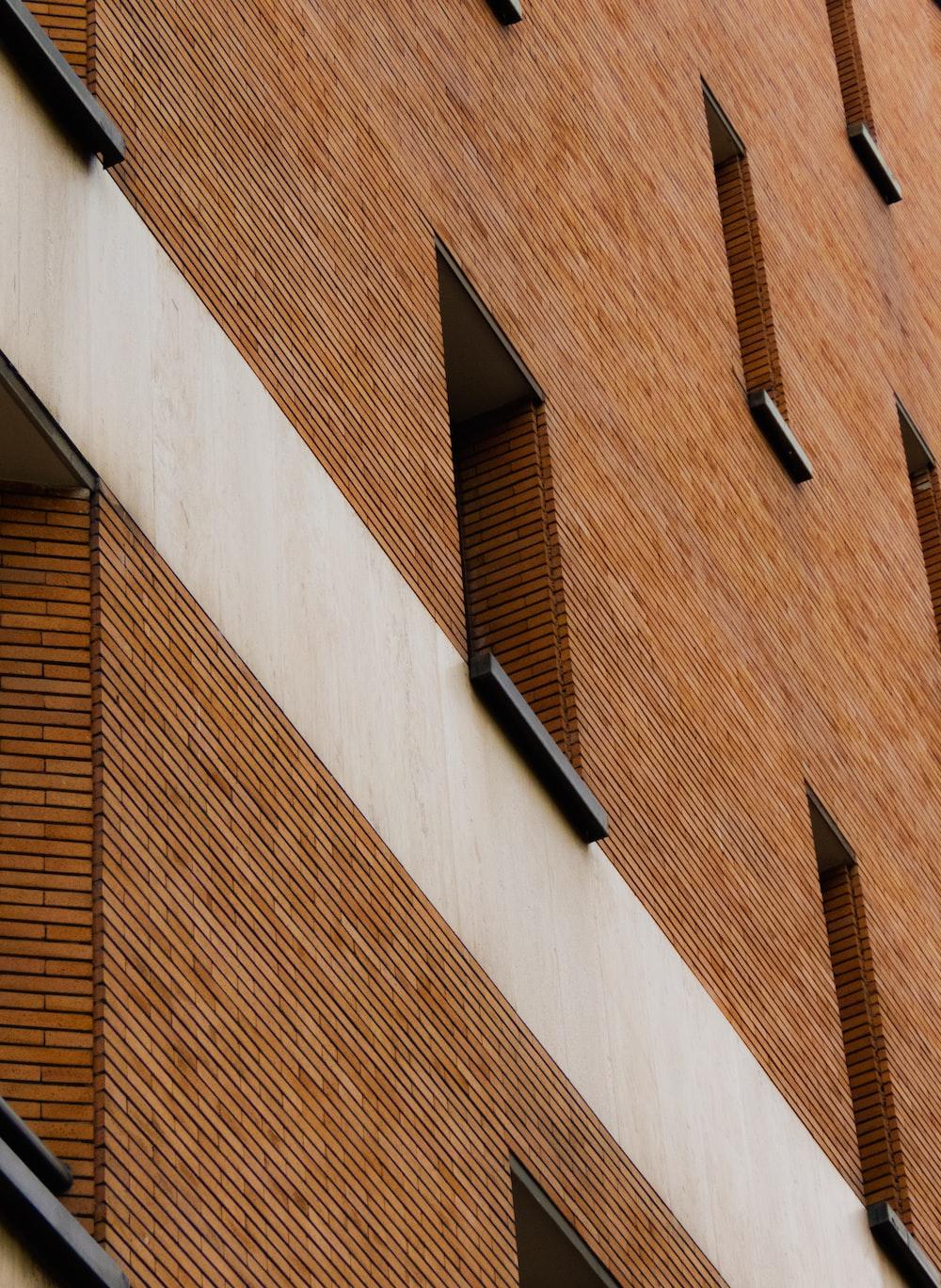 brown brick building with black window