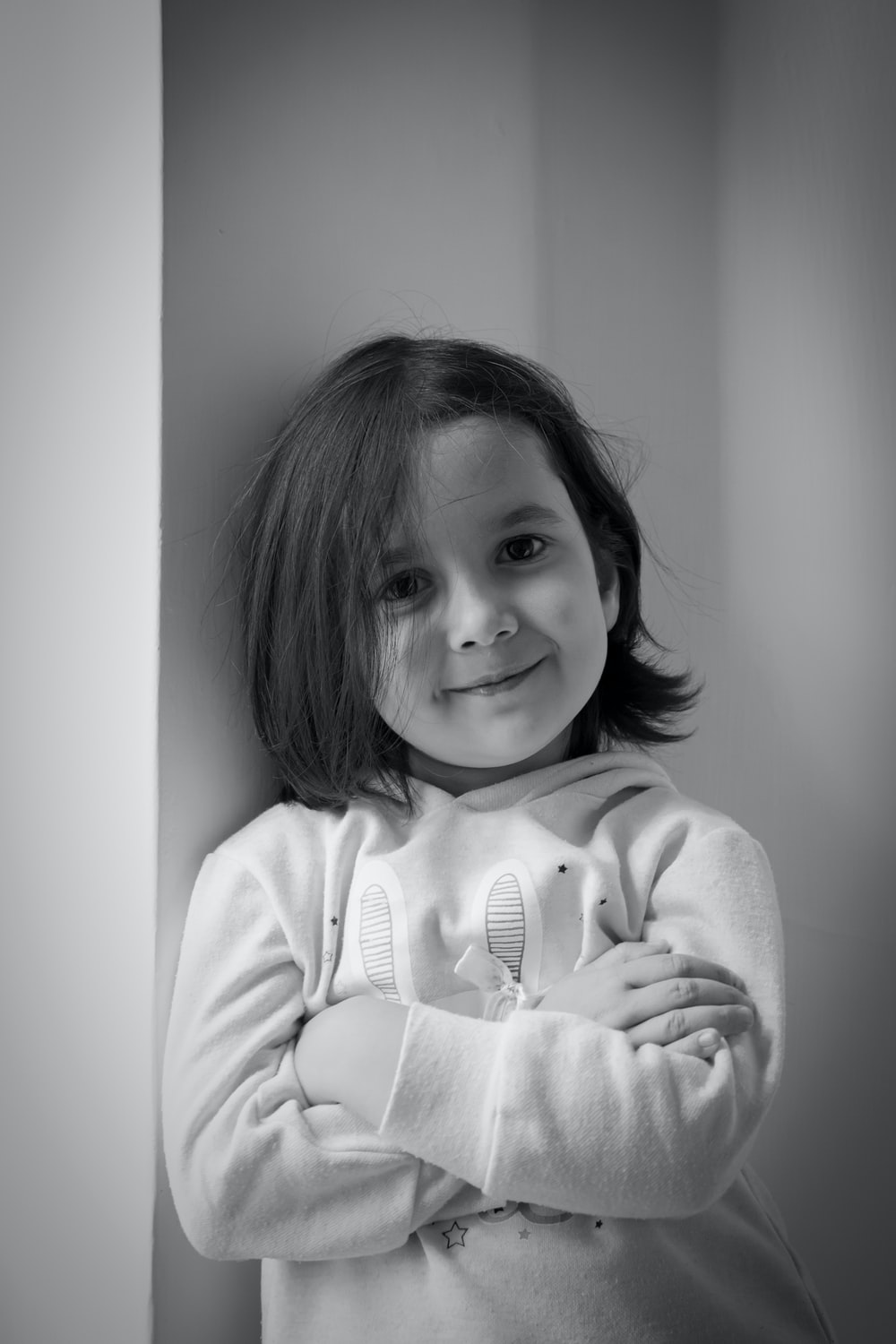 grayscale photo of girl in sweater