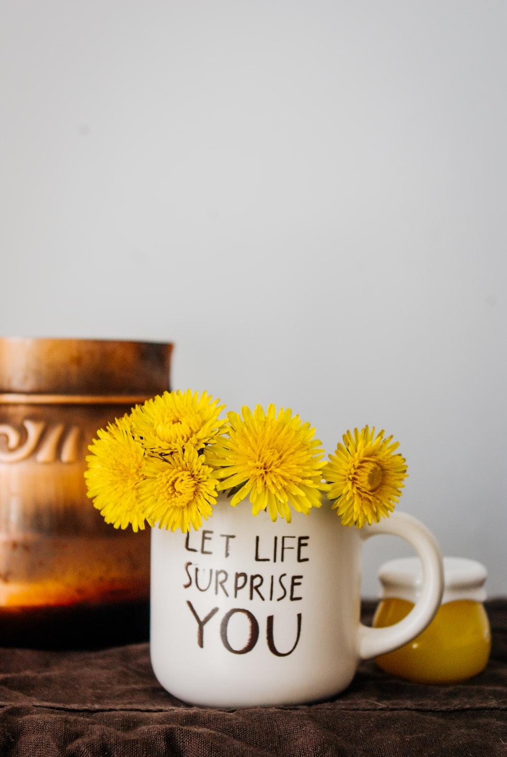 white ceramic mug with yellow flowers