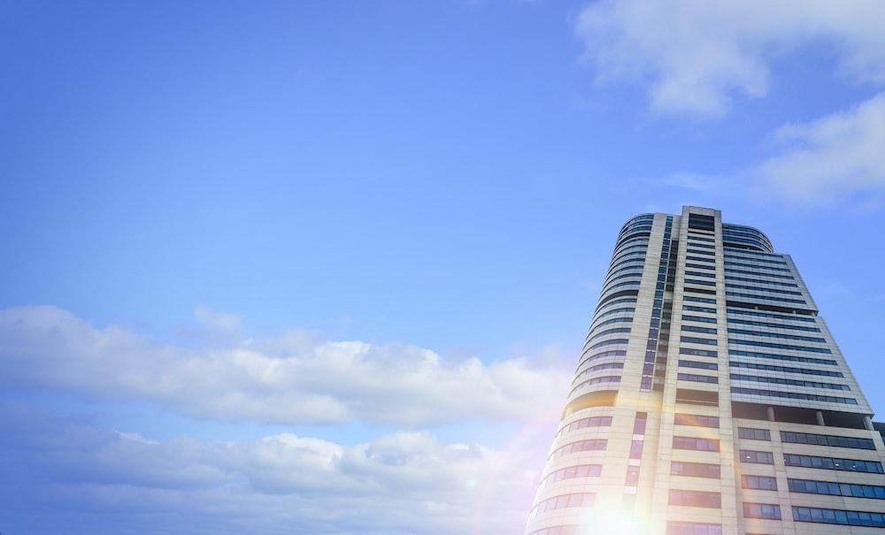 white and orange building under blue sky during daytime