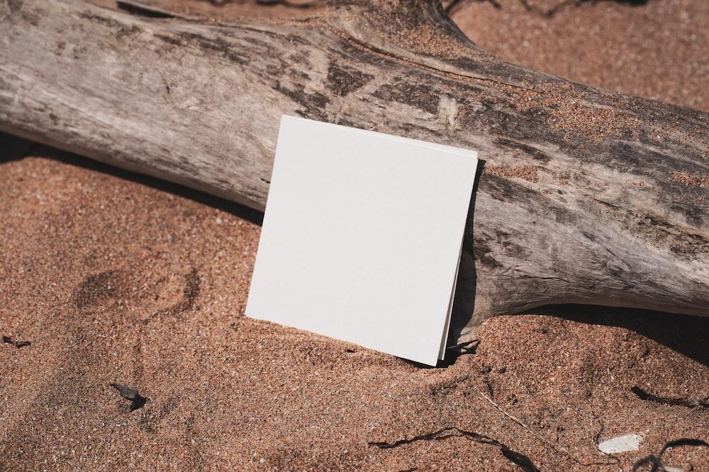 white printer paper on brown sand