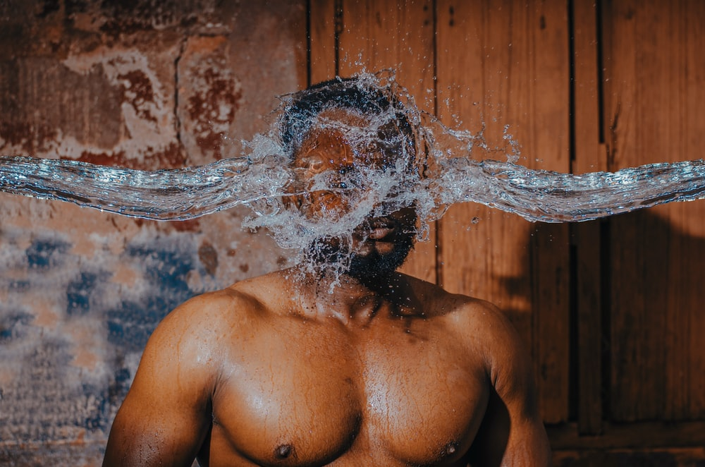 man with water splash on his face