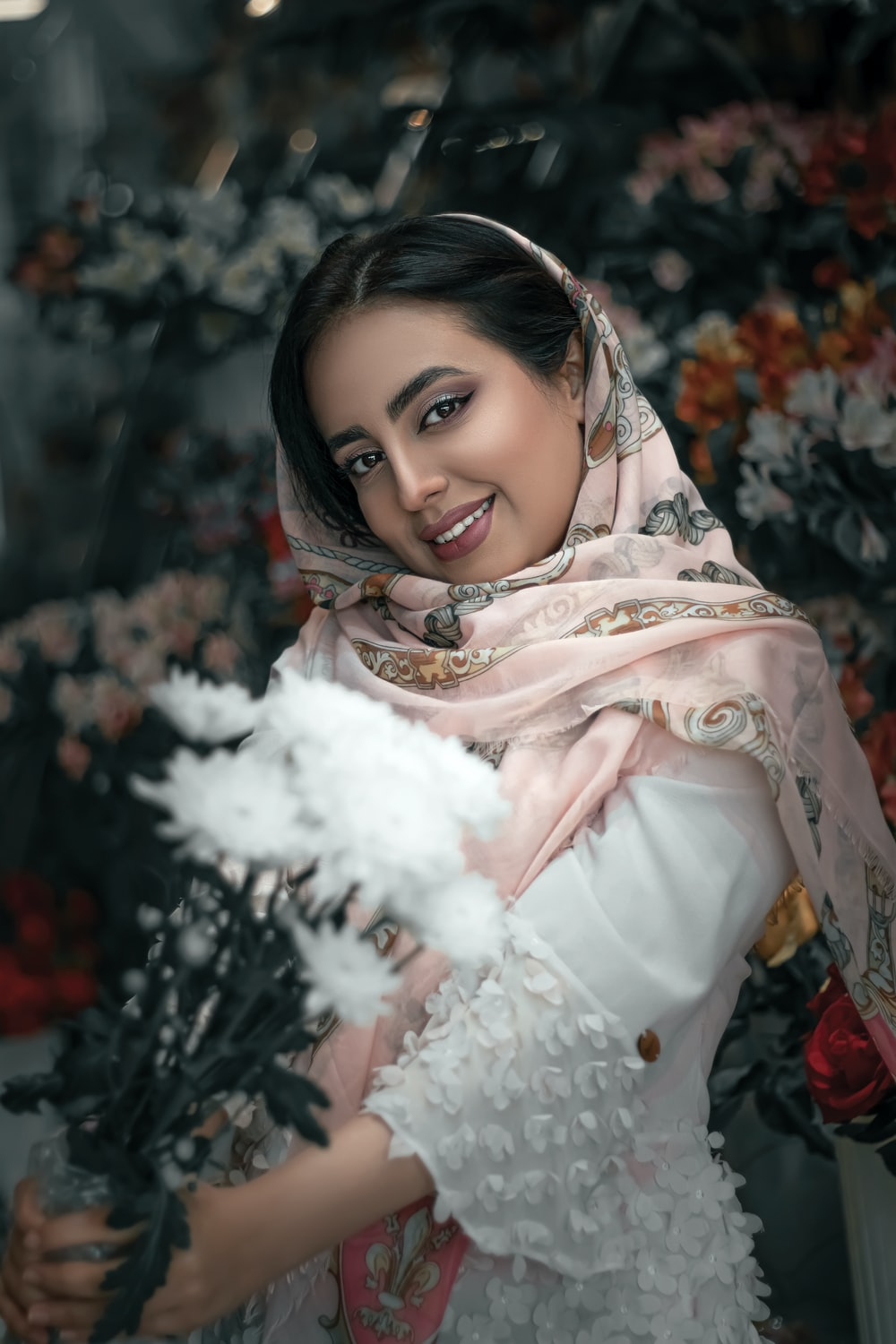 woman in white and brown floral hijab