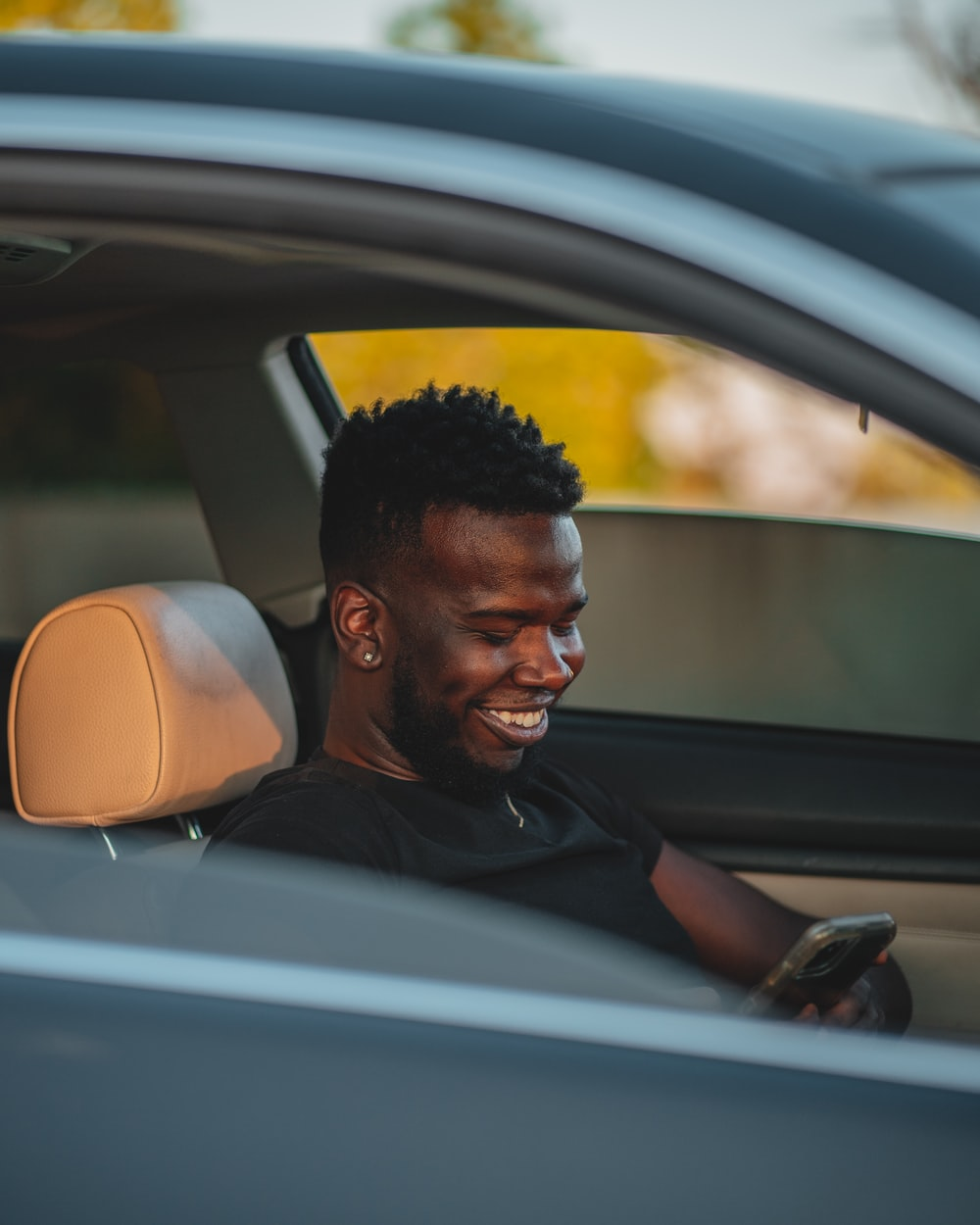 man in black shirt sitting inside car