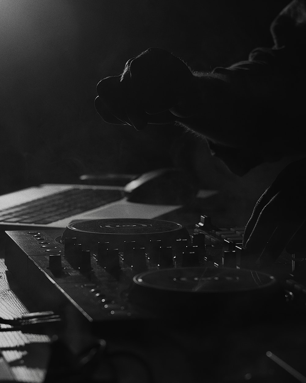 grayscale photo of person playing dj mixer
