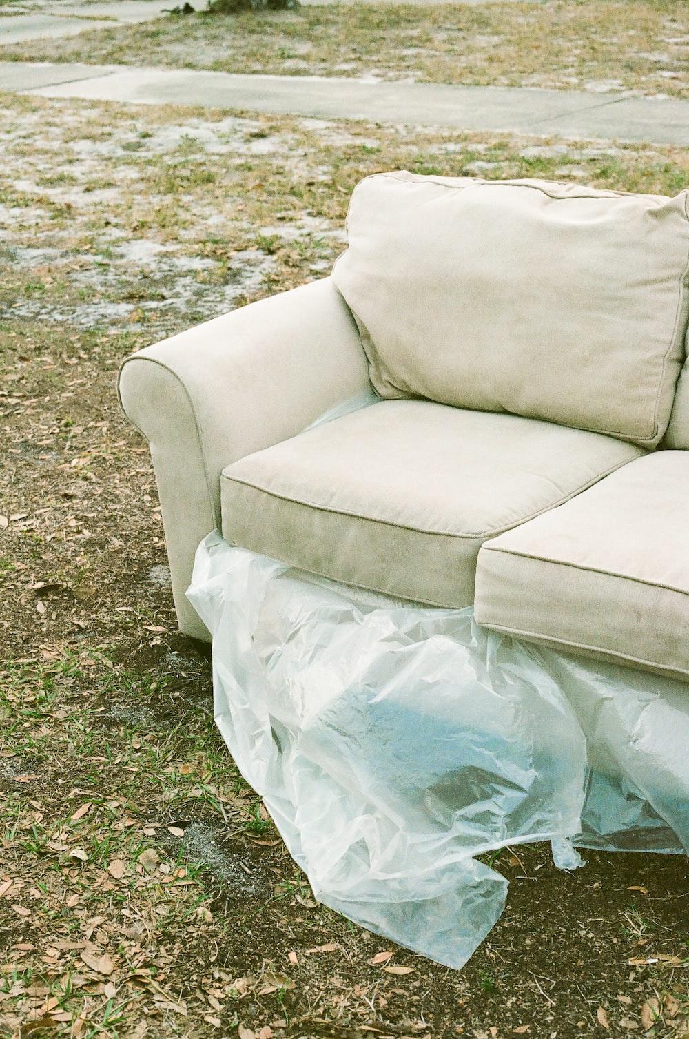 white sofa chair on green grass