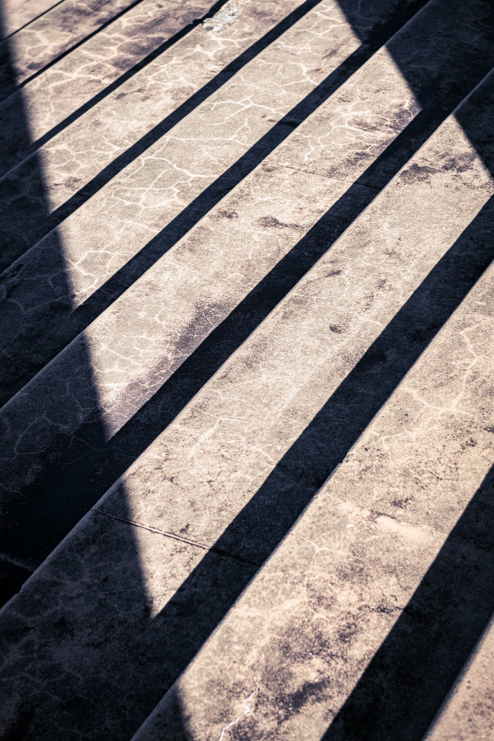shadow of person on gray concrete pavement